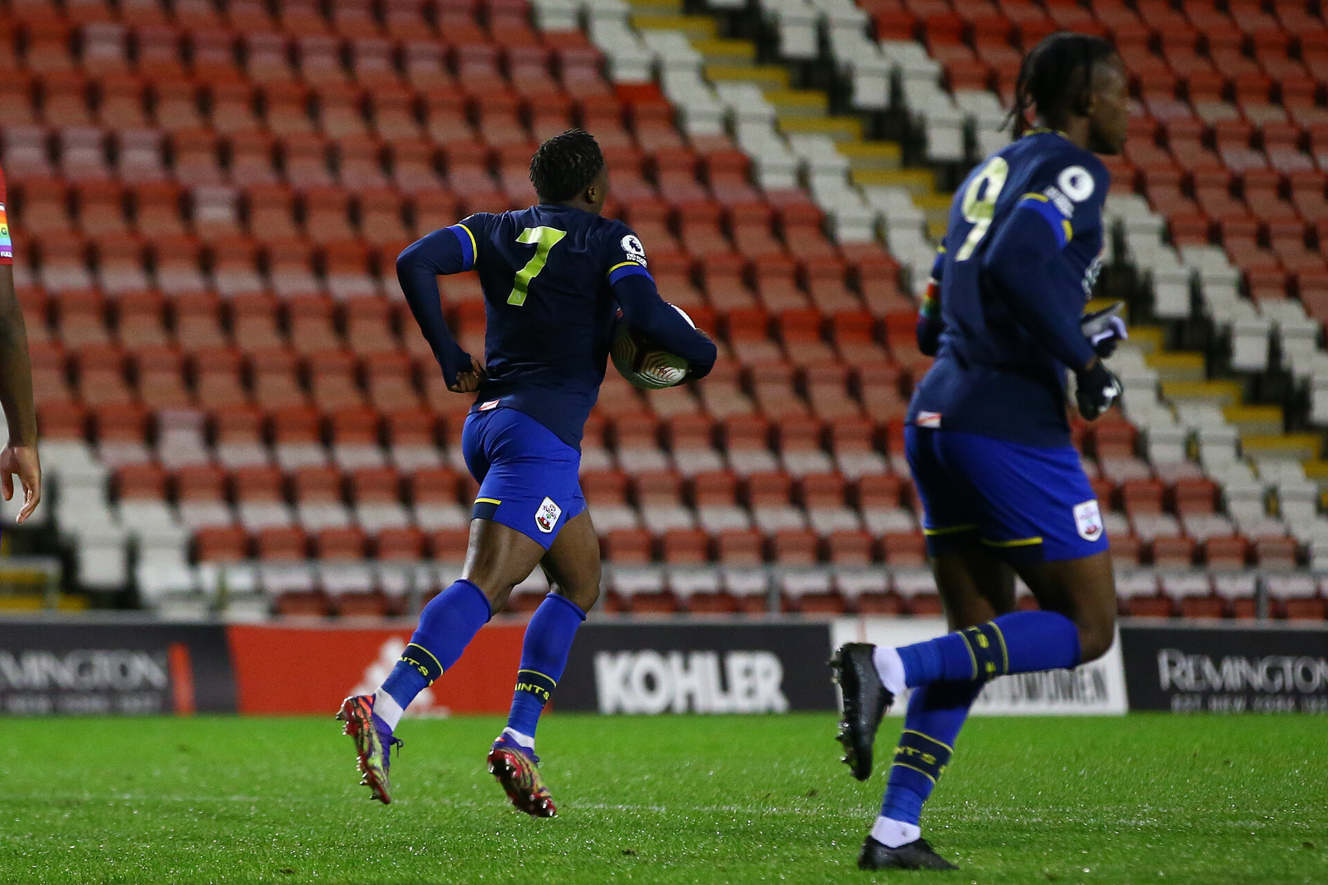 MANCHESTER, ENGLAND - DECEMBER 04: Michael Obafemi (L) of Southampton collects the after scoring during the Premier League 2 match between Manchester United and Southampton B Team at Leigh Sports Village on December 04, 2020 in Manchester, England. (Photo by Isabelle Field/Southampton FC via Getty Images)