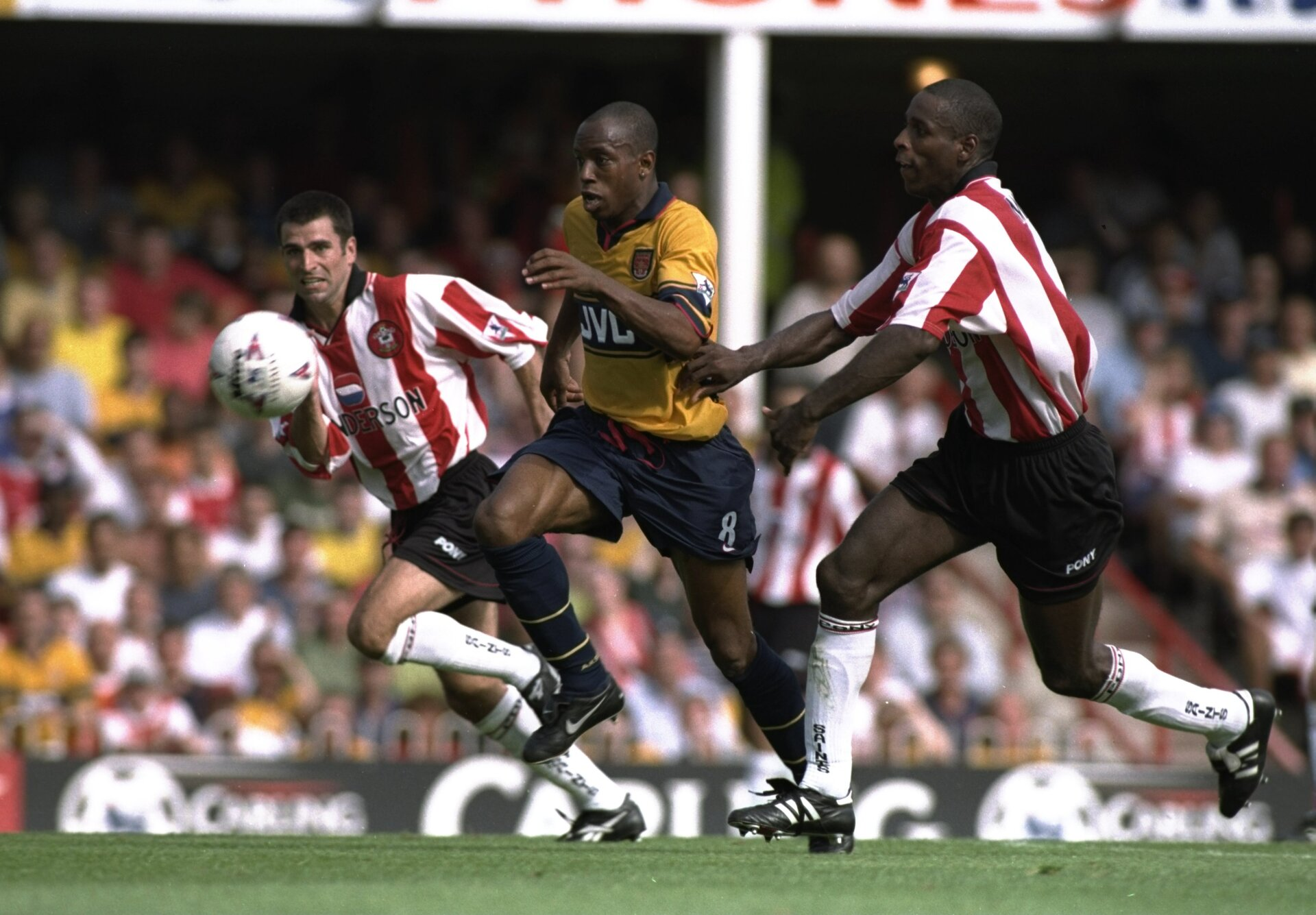 23 Aug 1997:  Ian Wright of Arsenal (centre) sprints away from Ken Monkou (right) and Francis Benali of Southampton during the FA Carling Premiership match at The Dell in Southampton, England. Arsenal won the match 1-3. \ Mandatory Credit: Allsport UK /Allsport