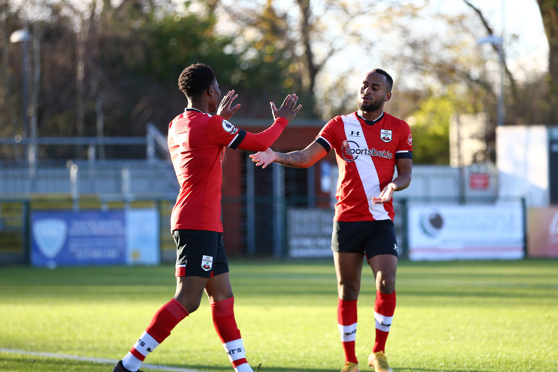 SOUTHAMPTON, ENGLAND - DECEMBER 12: Tyreke Johnson(R) congratulating Nathan Tella (L) on scoring during the Premier League 2 match between Southampton B Team and Leicester City at Snows Stadium on December 12, 2020 in Southampton, England. (Photo by Isabelle Field/Southampton FC via Getty Images)