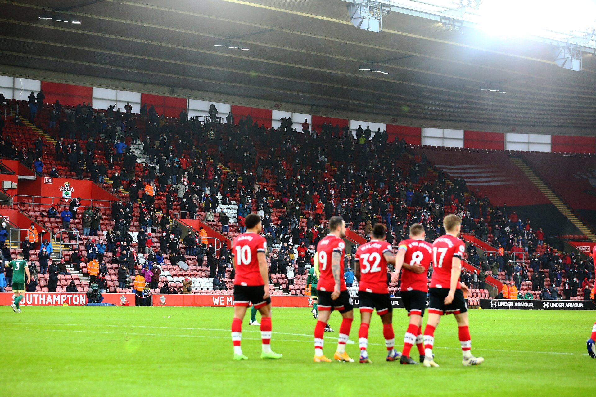 SOUTHAMPTON, ENGLAND - DECEMBER 13: Southampton fans celebrate after Stuart Armstrong makes it 2-0 during the Premier League match between Southampton and Sheffield United at St Mary's Stadium on December 13, 2020 in Southampton, England. A limited number of spectators (2000) are welcomed back to stadiums to watch elite football across England. This was following easing of restrictions on spectators in tiers one and two areas only. (Photo by Matt Watson/Southampton FC via Getty Images)