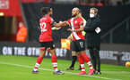 SOUTHAMPTON, ENGLAND - DECEMBER 13: Theo Walcott(L) of is replaced by Nathan Redmond during the Premier League match between Southampton and Sheffield United at St Mary's Stadium on December 13, 2020 in Southampton, England. A limited number of spectators (2000) are welcomed back to stadiums to watch elite football across England. This was following easing of restrictions on spectators in tiers one and two areas only. (Photo by Matt Watson/Southampton FC via Getty Images)