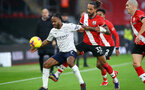 SOUTHAMPTON, ENGLAND - DECEMBER 19: Raheem Sterling (L) Manchester City and Theo Walcott (R) of Southampton during the Premier League match between Southampton and Manchester City at St Mary's Stadium on December 19, 2020 in Southampton, England. A limited number of fans (2000) are welcomed back to stadiums to watch elite football across England. This was following easing of restrictions on spectators in tiers one and two areas only. (Photo by Matt Watson/Southampton FC via Getty Images)