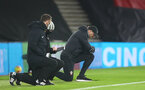 SOUTHAMPTON, ENGLAND - JANUARY 04: Ralph Hasenhuttl Southampton manager taking a knee in support of the Black Lives Matter movement ahead of the Premier League match between Southampton and Liverpool at St Mary's Stadium on January 04, 2021 in Southampton, England. (Photo by Matt Watson/Southampton FC via Getty Images)