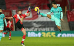 SOUTHAMPTON, ENGLAND - JANUARY 04: Jack Stephens (L) of Southampton and Roberto Firmino (R) of Liverpool during the Premier League match between Southampton and Liverpool at St Mary's Stadium on January 04, 2021 in Southampton, England. (Photo by Matt Watson/Southampton FC via Getty Images)