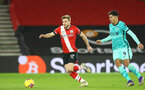 SOUTHAMPTON, ENGLAND - JANUARY 04: Stuart Armstrong (L) of Southampton during the Premier League match between Southampton and Liverpool at St Mary's Stadium on January 04, 2021 in Southampton, England. (Photo by Matt Watson/Southampton FC via Getty Images)