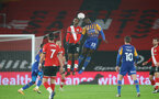 SOUTHAMPTON, ENGLAND - JANUARY 19: Ibrahima Diallo (L) of Southampton and Daniel Udoh (R) of Shrewsbury during the FA Cup Third Round match between Southampton and Shrewsbury Town on January 19, 2021 in Southampton, England. Sporting stadiums around the UK remain under strict restrictions due to the Coronavirus Pandemic as Government social distancing laws prohibit fans inside venues resulting in games being played behind closed doors. (Photo by Matt Watson/Southampton FC via Getty Images)