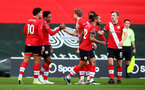 SOUTHAMPTON, ENGLAND - JANUARY 23: Kyle Walker-Peters(centre left) celebrates with his team mates after scoring during the FA Cup fourth round match between Southampton FC and Arsenal FC, at St.Mary's stadium, on January 23, 2021 in Southampton, England. Sporting stadiums around the UK remain under strict restrictions due to the Coronavirus Pandemic as Government social distancing laws prohibit fans inside venues resulting in games being played behind closed doors. (Photo by Matt Watson/Southampton FC via Getty Images)