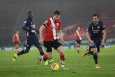 Arsenal fight back to clinch victory