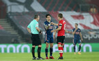 SOUTHAMPTON, ENGLAND - JANUARY 26: Hector Bellein(center) of Arsenal and James Ward-Prowse (R) of Southampton during the Premier League match between Southampton and Arsenal at St Mary's Stadium on January 26, 2021 in Southampton, England. Sporting stadiums around the UK remain under strict restrictions due to the Coronavirus Pandemic as Government social distancing laws prohibit fans inside venues resulting in games being played behind closed doors. (Photo by Chris Moorhouse/Southampton FC via Getty Images)