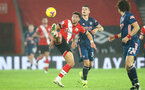 SOUTHAMPTON, ENGLAND - JANUARY 26: Ché Adams(L) of Southampton and Granit Xhaka (R) of Arsenal during the Premier League match between Southampton and Arsenal at St Mary's Stadium on January 26, 2021 in Southampton, England. Sporting stadiums around the UK remain under strict restrictions due to the Coronavirus Pandemic as Government social distancing laws prohibit fans inside venues resulting in games being played behind closed doors. (Photo by Matt Watson/Southampton FC via Getty Images)