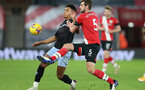 SOUTHAMPTON, ENGLAND - JANUARY 30: Ollie Watkins (L) of Aston Villa and Jack Stephens (R) of Southampton during the Premier League match between Southampton and Aston Villa at St Mary's Stadium on January 30, 2021 in Southampton, England. Sporting stadiums around the UK remain under strict restrictions due to the Coronavirus Pandemic as Government social distancing laws prohibit fans inside venues resulting in games being played behind closed doors. (Photo by Matt Watson/Southampton FC via Getty Images)