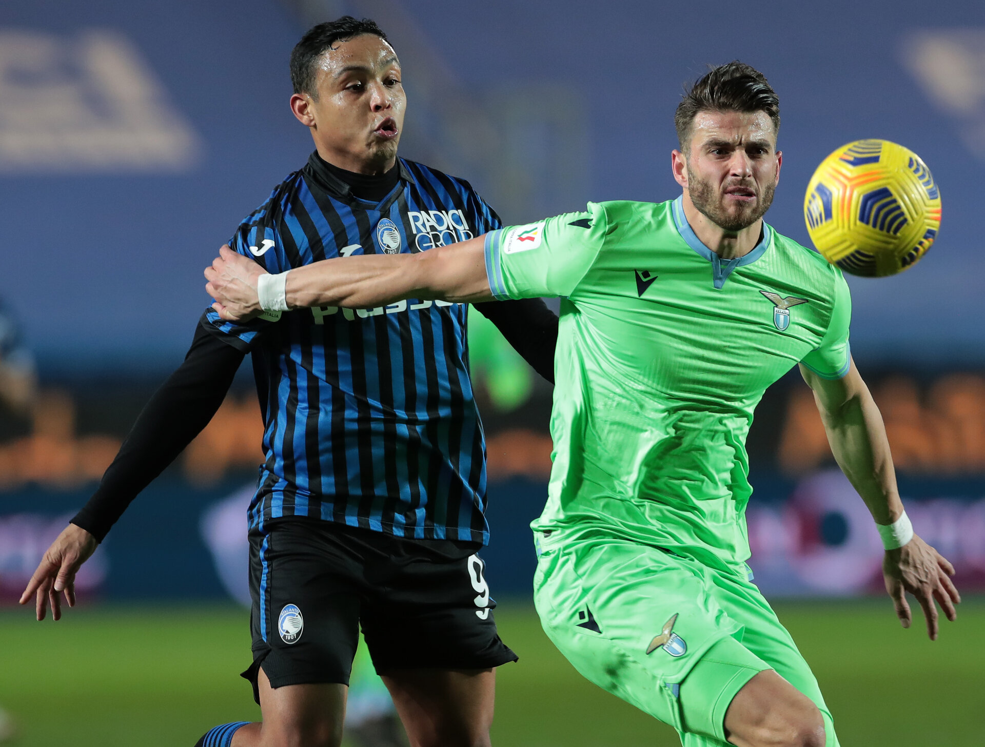 BERGAMO, ITALY - JANUARY 27:  Wesley Hoedt of SS Lazio competes for the ball with Luis Muriel of Atalanta BC during the Coppa Italia match between Atalanta BC and SS Lazio at Gewiss Stadium on January 27, 2021 in Bergamo, Italy. Sporting stadiums around Italy remain under strict restrictions due to the Coronavirus Pandemic as Government social distancing laws prohibit fans inside venues resulting in games being played behind closed doors. (Photo by Emilio Andreoli/Getty Images)