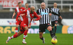 NEWCASTLE UPON TYNE, ENGLAND - FEBRUARY 06: Nathan Redmond (L) of Southampton and Jonjo Shelvey (R) of Newcastle during the Premier League match between Newcastle United and Southampton at St. James Park on February 06, 2021 in Newcastle upon Tyne, England. Sporting stadiums around the UK remain under strict restrictions due to the Coronavirus Pandemic as Government social distancing laws prohibit fans inside venues resulting in games being played behind closed doors. (Photo by Matt Watson/Southampton FC via Getty Images)