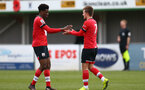 SOUTHAMPTON, ENGLAND - FEBRUARY 07: David Agbontohoma (L) of Southampton congratulates Sam Bellis (R) of Southampton on scoring during the Premier League 2 match between  Southampton B Team and Tottenham Hotspur at Snows Stadium on February 07, 2021 in Southampton, England. (Photo by Isabelle Field/Southampton FC via Getty Images)