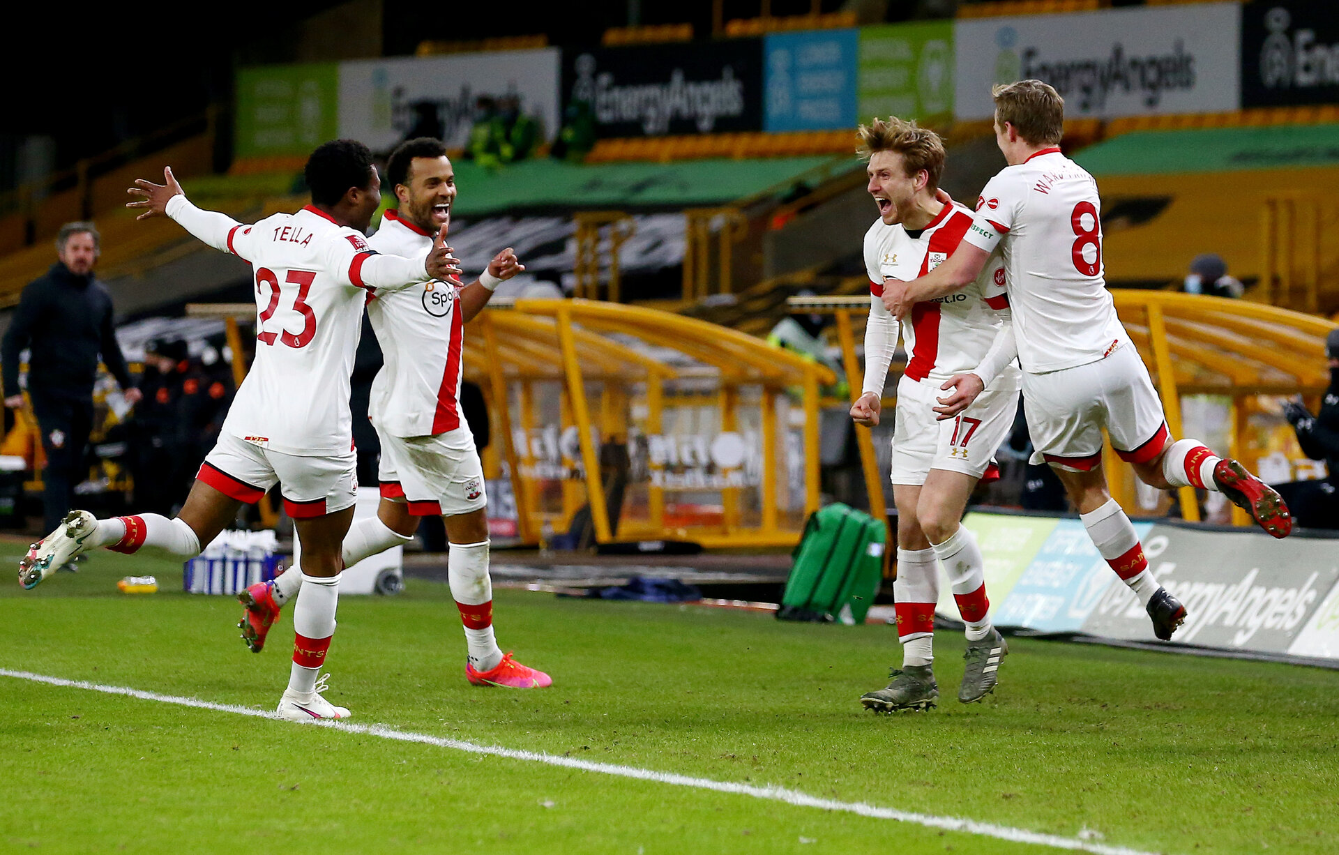 WOLVERHAMPTON, ENGLAND - FEBRUARY 11: Stuart Armstrong(second from the right) of celebrates with team mates after scoring during The Emirates FA Cup Fifth Round match between Wolverhampton Wanderers and Southampton at Molineux on February 11, 2021 in Wolverhampton, England. Sporting stadiums around the UK remain under strict restrictions due to the Coronavirus Pandemic as Government social distancing laws prohibit fans inside venues resulting in games being played behind closed doors. (Photo by Matt Watson/Southampton FC via Getty Images)