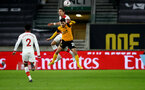 WOLVERHAMPTON, ENGLAND - FEBRUARY 11: Jan Bednarek of Southampton wins a header against Vitor Ferreira of Wolves during The Emirates FA Cup Fifth Round match between Wolverhampton Wanderers and Southampton at Molineux on February 11, 2021 in Wolverhampton, England. Sporting stadiums around the UK remain under strict restrictions due to the Coronavirus Pandemic as Government social distancing laws prohibit fans inside venues resulting in games being played behind closed doors. (Photo by Matt Watson/Southampton FC via Getty Images)