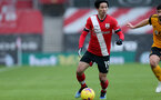 SOUTHAMPTON, ENGLAND - FEBRUARY 14: Takumi Minamino of Southampton during the Premier League match between Southampton and Wolverhampton Wanderers at St Mary's Stadium on February 14, 2021 in Southampton, England. Sporting stadiums around the UK remain under strict restrictions due to the Coronavirus Pandemic as Government social distancing laws prohibit fans inside venues resulting in games being played behind closed doors. (Photo by Matt Watson/Southampton FC via Getty Images)