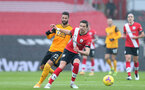 SOUTHAMPTON, ENGLAND - FEBRUARY 14: Willian Jose (L) of Wolves and Jan Bednarek (R) of Southampton during the Premier League match between Southampton and Wolverhampton Wanderers at St Mary's Stadium on February 14, 2021 in Southampton, England. Sporting stadiums around the UK remain under strict restrictions due to the Coronavirus Pandemic as Government social distancing laws prohibit fans inside venues resulting in games being played behind closed doors. (Photo by Matt Watson/Southampton FC via Getty Images)