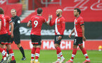 SOUTHAMPTON, ENGLAND - FEBRUARY 14: Nathan Redmond(R)   of Southampton congratulates Danny Ings (L) of Southampton on opening the scoring during the Premier League match between Southampton and Wolverhampton Wanderers at St Mary's Stadium on February 14, 2021 in Southampton, England. Sporting stadiums around the UK remain under strict restrictions due to the Coronavirus Pandemic as Government social distancing laws prohibit fans inside venues resulting in games being played behind closed doors. (Photo by Matt Watson/Southampton FC via Getty Images)