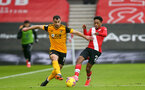 SOUTHAMPTON, ENGLAND - FEBRUARY 14: Jonny (L) of Wolves and Kyle Walker-Peters of Southampton during the Premier League match between Southampton and Wolverhampton Wanderers at St Mary's Stadium on February 14, 2021 in Southampton, England. Sporting stadiums around the UK remain under strict restrictions due to the Coronavirus Pandemic as Government social distancing laws prohibit fans inside venues resulting in games being played behind closed doors. (Photo by Matt Watson/Southampton FC via Getty Images)
