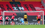 SOUTHAMPTON, ENGLAND - FEBRUARY 14: Alex McCarthy of Southampton unable to stop the wolves penalty during the Premier League match between Southampton and Wolverhampton Wanderers at St Mary's Stadium on February 14, 2021 in Southampton, England. Sporting stadiums around the UK remain under strict restrictions due to the Coronavirus Pandemic as Government social distancing laws prohibit fans inside venues resulting in games being played behind closed doors. (Photo by Matt Watson/Southampton FC via Getty Images)