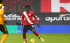 SOUTHAMPTON, ENGLAND - FEBRUARY 14: Mohammed Salisu of Southampton during the Premier League match between Southampton and Wolverhampton Wanderers at St Mary's Stadium on February 14, 2021 in Southampton, England. Sporting stadiums around the UK remain under strict restrictions due to the Coronavirus Pandemic as Government social distancing laws prohibit fans inside venues resulting in games being played behind closed doors. (Photo by Matt Watson/Southampton FC via Getty Images)
