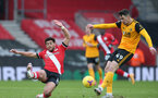 SOUTHAMPTON, ENGLAND - FEBRUARY 14: Ché Adams (L) of Southampton and Maximilian Kilman (R) of Wolves during the Premier League match between Southampton and Wolverhampton Wanderers at St Mary's Stadium on February 14, 2021 in Southampton, England. Sporting stadiums around the UK remain under strict restrictions due to the Coronavirus Pandemic as Government social distancing laws prohibit fans inside venues resulting in games being played behind closed doors. (Photo by Matt Watson/Southampton FC via Getty Images)
