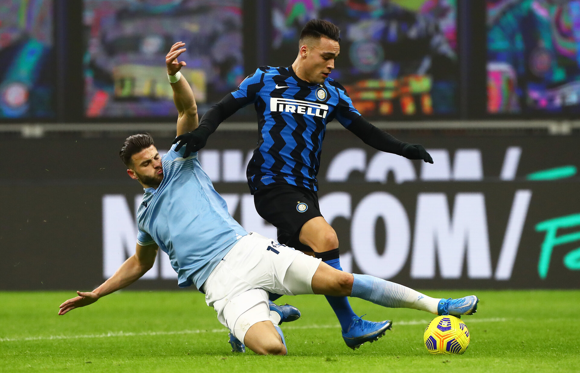 MILAN, ITALY - FEBRUARY 14: Lautaro Martinez of FC Internazionale is tackled by Wesley Hoedt of S.S. Lazio during the Serie A match between FC Internazionale  and SS Lazio at Stadio Giuseppe Meazza on February 14, 2021 in Milan, Italy. Sporting stadiums around Italy remain under strict restrictions due to the Coronavirus Pandemic as Government social distancing laws prohibit fans inside venues resulting in games being played behind closed doors. (Photo by Marco Luzzani/Getty Images)