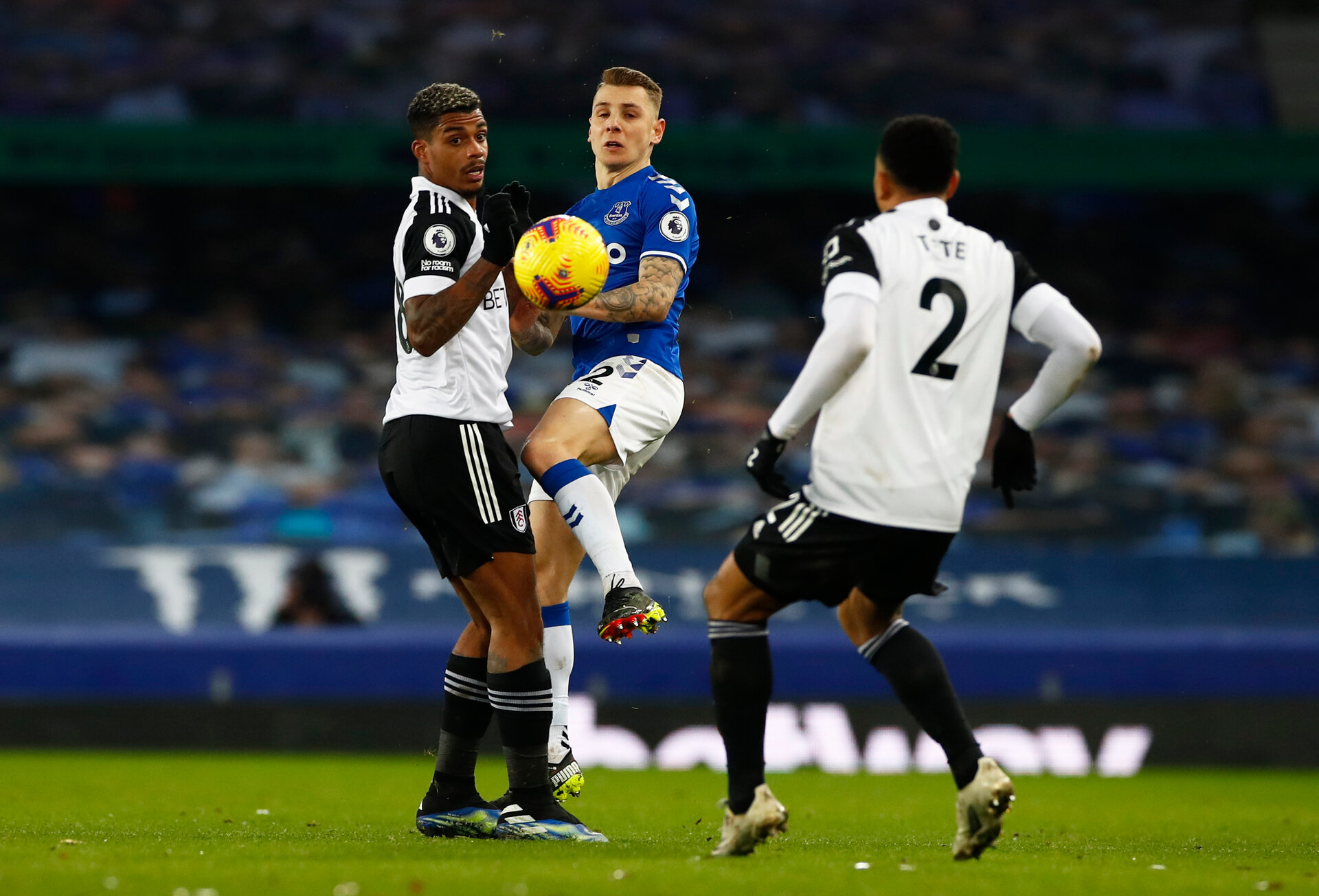 LIVERPOOL, ENGLAND - FEBRUARY 14: Lucas Digne of Everton and Mario Lemina of Fulham battle for the ball  during the Premier League match between Everton and Fulham at Goodison Park on February 14, 2021 in Liverpool, England. Sporting stadiums around the UK remain under strict restrictions due to the Coronavirus Pandemic as Government social distancing laws prohibit fans inside venues resulting in games being played behind closed doors. (Photo by Jason Cairnduff - Pool/Getty Images)