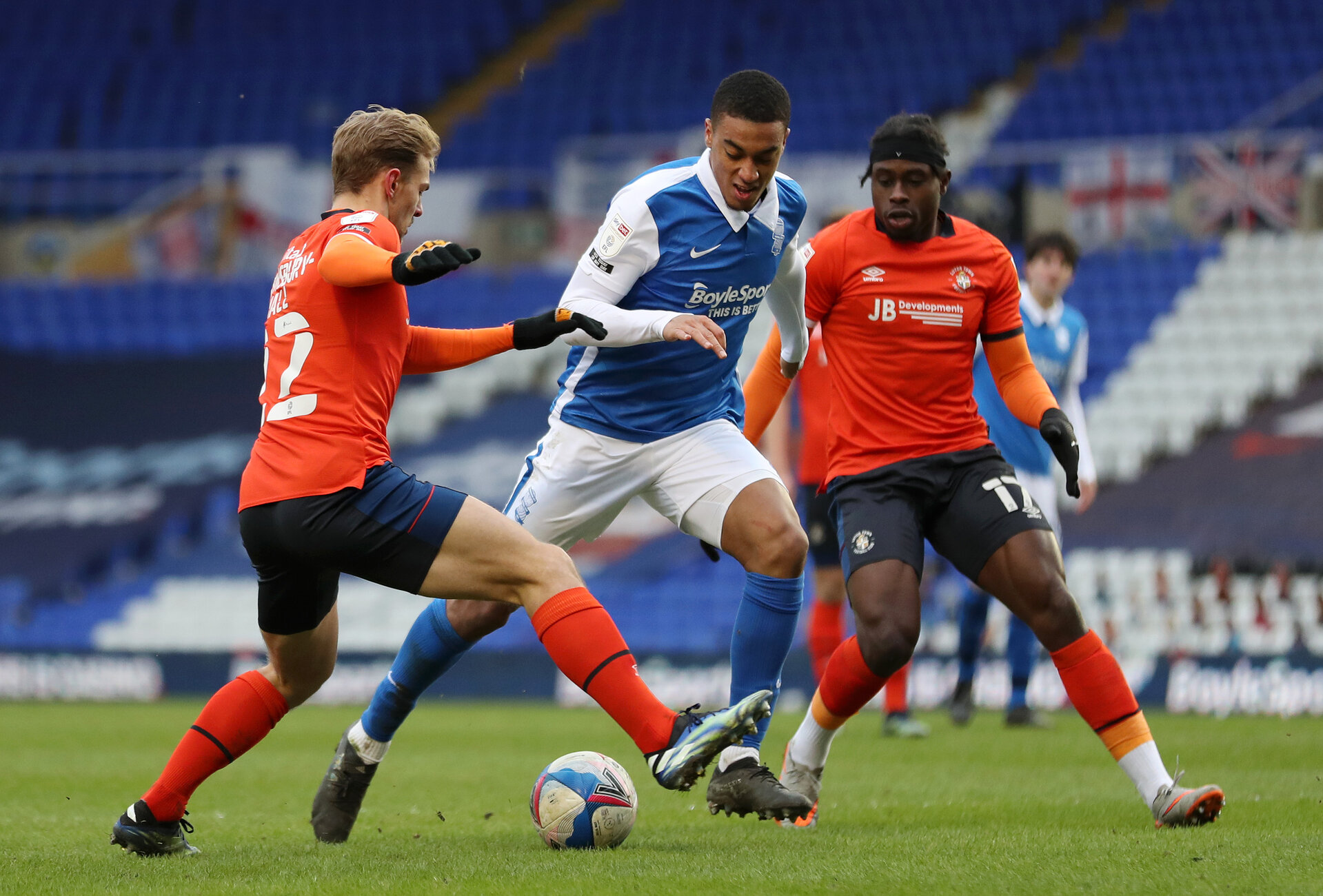 BIRMINGHAM, ENGLAND - FEBRUARY 13: Yan Valery of Birmingham City controls the ball as Kiernan Dewsbury-Hall of Luton Town and Pelly Ruddock of Luton Town look on during the Sky Bet Championship match between Birmingham City and Luton Town at St Andrew's Trillion Trophy Stadium on February 13, 2021 in Birmingham, England. Sporting stadiums around the UK remain under strict restrictions due to the Coronavirus Pandemic as Government social distancing laws prohibit fans inside venues resulting in games being played behind closed doors. (Photo by Naomi Baker/Getty Images)