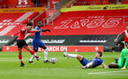SOUTHAMPTON, ENGLAND - FEBRUARY 20: Takumi Minamino (L) of Southampton opens the scoring during the Premier League match between Southampton and Chelsea at St Mary's Stadium on February 20, 2021 in Southampton, England. Sporting stadiums around the UK remain under strict restrictions due to the Coronavirus Pandemic as Government social distancing laws prohibit fans inside venues resulting in games being played behind closed doors. (Photo by Matt Watson/Southampton FC via Getty Images)