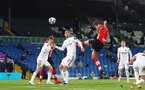 LEEDS, ENGLAND - FEBRUARY 23: Jannik Vestergaard (R) of Southampton with header from corner during the Premier League match between Leeds United and Southampton at Elland Road on February 23, 2021 in Leeds, England. Sporting stadiums around the UK remain under strict restrictions due to the Coronavirus Pandemic as Government social distancing laws prohibit fans inside venues resulting in games being played behind closed doors. (Photo by Matt Watson/Southampton FC via Getty Images)
