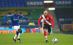 LIVERPOOL, ENGLAND - MARCH 01: Abdoulaye Doucoure (L) of Everton and Nathan Redmond (R) of Southampton during the Premier League match between Everton and Southampton at Goodison Park on March 01, 2021 in Liverpool, England. Sporting stadiums around the UK remain under strict restrictions due to the Coronavirus Pandemic as Government social distancing laws prohibit fans inside venues resulting in games being played behind closed doors. (Photo by Matt Watson/Southampton FC via Getty Images)