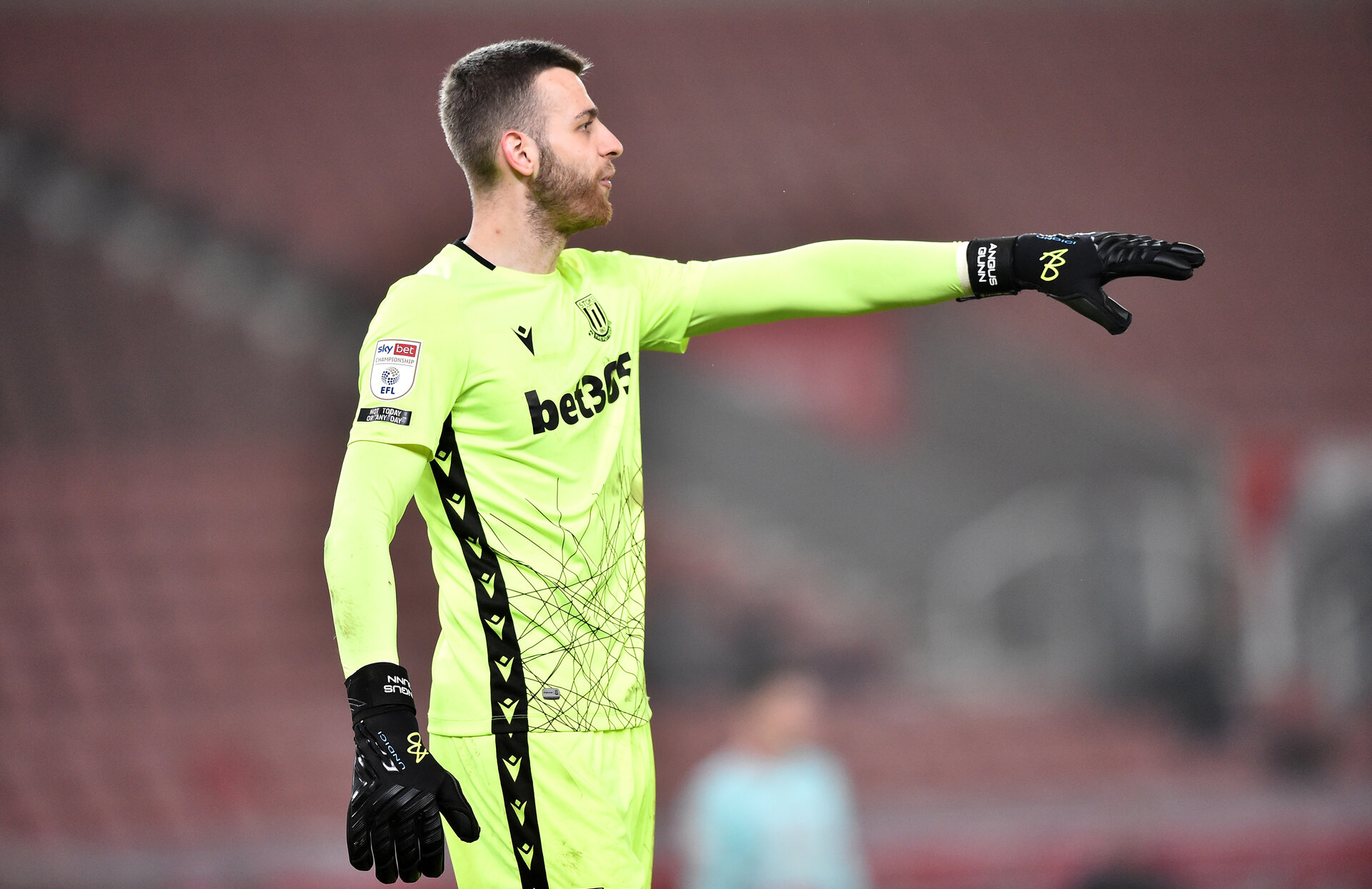 STOKE ON TRENT, ENGLAND - MARCH 03: Angus Gunn of Stoke City organizes his defense during the Sky Bet Championship match between Stoke City and Swansea City at Bet365 Stadium on March 03, 2021 in Stoke on Trent, [STATE Sporting stadiums around the UK remain under strict restrictions due to the Coronavirus Pandemic as Government social distancing laws prohibit fans inside venues resulting in games being played behind closed doors. (Photo by Nathan Stirk/Getty Images)