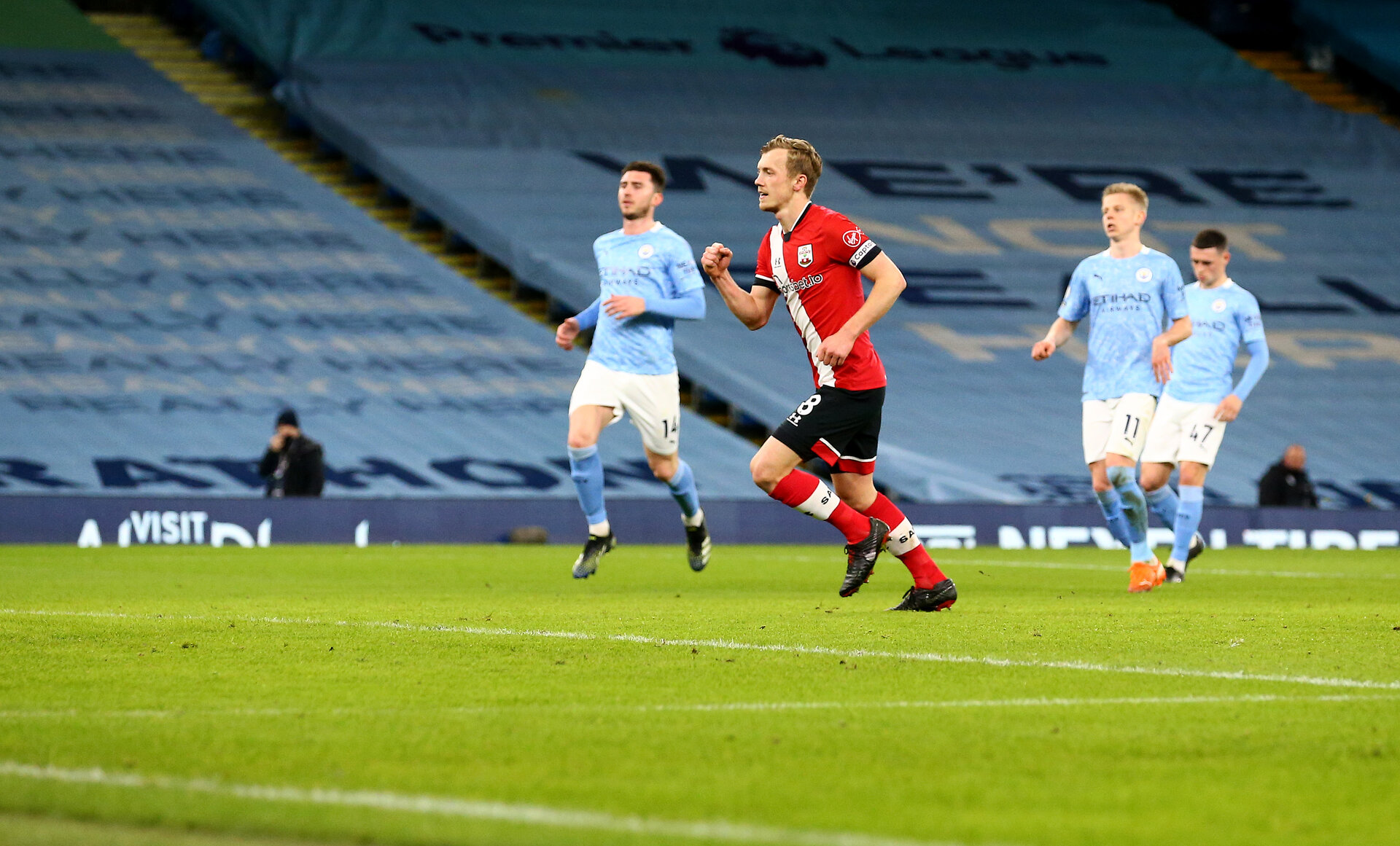 MANCHESTER, ENGLAND - MARCH 10: James Ward-Prowse of Southampton celebrates after scoring from the penalty spot to make it 1-1 during the Premier League match between Manchester City and Southampton at Etihad Stadium on March 10, 2021 in Manchester, England. Sporting stadiums around the UK remain under strict restrictions due to the Coronavirus Pandemic as Government social distancing laws prohibit fans inside venues resulting in games being played behind closed doors. (Photo by Matt Watson/Southampton FC via Getty Images)