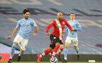 MANCHESTER, ENGLAND - MARCH 10: Ilkay Gundogan (L) of Manchester City and Nathan Redmond (R) of Southampton during the Premier League match between Manchester City and Southampton at Etihad Stadium on March 10, 2021 in Manchester, England. Sporting stadiums around the UK remain under strict restrictions due to the Coronavirus Pandemic as Government social distancing laws prohibit fans inside venues resulting in games being played behind closed doors. (Photo by Matt Watson/Southampton FC via Getty Images)
