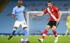 MANCHESTER, ENGLAND - MARCH 10: Fernandinho (L) Manchester City and Jack Stephens (R) of Southampton during the Premier League match between Manchester City and Southampton at Etihad Stadium on March 10, 2021 in Manchester, England. Sporting stadiums around the UK remain under strict restrictions due to the Coronavirus Pandemic as Government social distancing laws prohibit fans inside venues resulting in games being played behind closed doors. (Photo by Matt Watson/Southampton FC via Getty Images)
