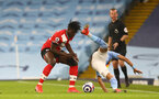 MANCHESTER, ENGLAND - MARCH 10: Mohammed Salisu (L) of Southampton  during the Premier League match between Manchester City and Southampton at Etihad Stadium on March 10, 2021 in Manchester, England. Sporting stadiums around the UK remain under strict restrictions due to the Coronavirus Pandemic as Government social distancing laws prohibit fans inside venues resulting in games being played behind closed doors. (Photo by Matt Watson/Southampton FC via Getty Images)