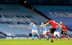 MANCHESTER, ENGLAND - MARCH 10: James Ward-Prowse takes penalty and scores during the Premier League match between Manchester City and Southampton at Etihad Stadium on March 10, 2021 in Manchester, England. Sporting stadiums around the UK remain under strict restrictions due to the Coronavirus Pandemic as Government social distancing laws prohibit fans inside venues resulting in games being played behind closed doors. (Photo by Matt Watson/Southampton FC via Getty Images)