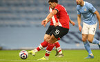MANCHESTER, ENGLAND - MARCH 10: Ché Adams of Southampton  scoring in second half during the Premier League match between Manchester City and Southampton at Etihad Stadium on March 10, 2021 in Manchester, England. Sporting stadiums around the UK remain under strict restrictions due to the Coronavirus Pandemic as Government social distancing laws prohibit fans inside venues resulting in games being played behind closed doors. (Photo by Matt Watson/Southampton FC via Getty Images)