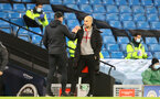MANCHESTER, ENGLAND - MARCH 10: Ralph Hasenhuttl (L) Southampton manager and Pep Guardiola (R) Manchester City manager during the Premier League match between Manchester City and Southampton at Etihad Stadium on March 10, 2021 in Manchester, England. Sporting stadiums around the UK remain under strict restrictions due to the Coronavirus Pandemic as Government social distancing laws prohibit fans inside venues resulting in games being played behind closed doors. (Photo by Matt Watson/Southampton FC via Getty Images)