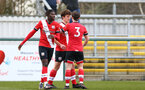 SOUTHAMPTON, ENGLAND - MARCH 21: Luke Pearce (center) celebrates scoring with team mates Alex Janekewitz  (L) and Will Ferry (R) during the Premier League 2 match between Southampton B Team and Liverpool at the Snows Stadium on March 21, 2021 in Southampton, England.  (Photo by Isabelle Field/Southampton FC via Getty Images)