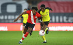SOUTHAMPTON, ENGLAND - MARCH 23: Ramello Mitchell (L) of Southampton  during the FA Youth Cup fourth round match between Southampton and Burton Albion at St Mary's Stadium on March 23, 2021 in Southampton, England. (Photo by Isabelle Field/Southampton FC via Getty Images)