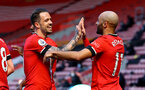 SOUTHAMPTON, ENGLAND - APRIL 04: Danny Ings(L) and Nathan Redmond of Southampton celebrate during the Premier League match between Southampton and Burnley at St Mary's Stadium on April 04, 2021 in Southampton, England. Sporting stadiums around the UK remain under strict restrictions due to the Coronavirus Pandemic as Government social distancing laws prohibit fans inside venues resulting in games being played behind closed doors. (Photo by Matt Watson/Southampton FC via Getty Images)