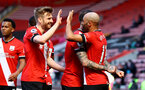 SOUTHAMPTON, ENGLAND - APRIL 04: Stuart Armstrong(L) and Nathan Redmond of Southampton celebrate during the Premier League match between Southampton and Burnley at St Mary's Stadium on April 04, 2021 in Southampton, England. Sporting stadiums around the UK remain under strict restrictions due to the Coronavirus Pandemic as Government social distancing laws prohibit fans inside venues resulting in games being played behind closed doors. (Photo by Matt Watson/Southampton FC via Getty Images)
