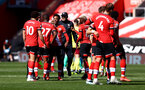 SOUTHAMPTON, ENGLAND - APRIL 04: Kyle Walker-Peters(centre) of Southampton celebrates at the final whistle during the Premier League match between Southampton and Burnley at St Mary's Stadium on April 04, 2021 in Southampton, England. Sporting stadiums around the UK remain under strict restrictions due to the Coronavirus Pandemic as Government social distancing laws prohibit fans inside venues resulting in games being played behind closed doors. (Photo by Matt Watson/Southampton FC via Getty Images)