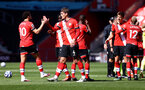 SOUTHAMPTON, ENGLAND - APRIL 04: Che Adams(L) and Jannik Vestergaard of Southampton at the final whistle during the Premier League match between Southampton and Burnley at St Mary's Stadium on April 04, 2021 in Southampton, England. Sporting stadiums around the UK remain under strict restrictions due to the Coronavirus Pandemic as Government social distancing laws prohibit fans inside venues resulting in games being played behind closed doors. (Photo by Matt Watson/Southampton FC via Getty Images)