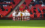LONDON, ENGLAND - APRIL 18: Sants players huddle during the Semi Final of the Emirates FA Cup match between Leicester City and Southampton FC at Wembley Stadium on April 18, 2021 in London, England. 4000 local residents have been permitted to attend the match as part of the government's Events Research Programme, which will study how to safely hold major events once coronavirus lockdown measures are eased. Other sporting events around the United Kingdom continue to be played behind closed doors. (Photo by Matt Watson/Southampton FC via Getty Images)