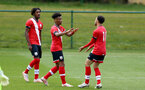READING, ENGLAND - APRIL 27: Fedel Ross-Lang (center) of Southampton celebrates scoring with team mate Jayden Smith (R) of Southampton during the Premier League U18s match between Reading and Southampton U18s at Bearwood Park Training Ground on April 27, 2021 in Reading, England. (Photo by Isabelle Field/Southampton FC via Getty Images)