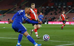 SOUTHAMPTON, ENGLAND - APRIL 30: Youri Tielemans (L) of Leicester and Stuart Armstrong (R) of Southampton during the Premier League match between Southampton and Leicester City at St Mary's Stadium on April 30, 2021 in Southampton, England. Sporting stadiums around the UK remain under strict restrictions due to the Coronavirus Pandemic as Government social distancing laws prohibit fans inside venues resulting in games being played behind closed doors.  (Photo by Isabelle Field/Southampton FC via Getty Images)